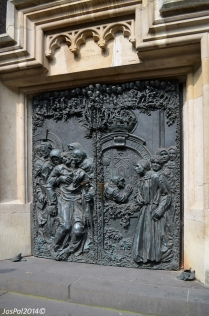 One of the many elaborate doors, depicting the disabled, praying for a cure