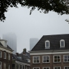 Buildings almost obscured by the clouds